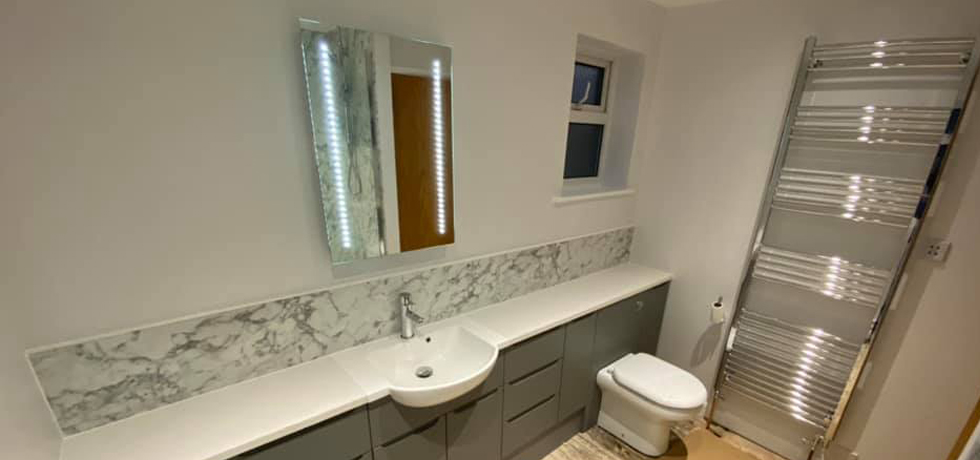 Nuance panels in Marmo Bianco fitted by G D Evans Interiors