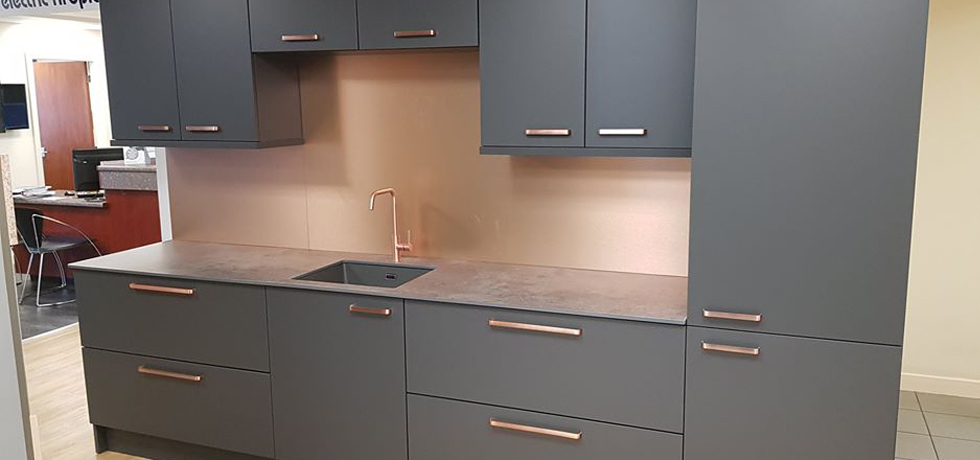 Evolve Caldeira on display at Homecare Supplies, with Brushed Copper splashback