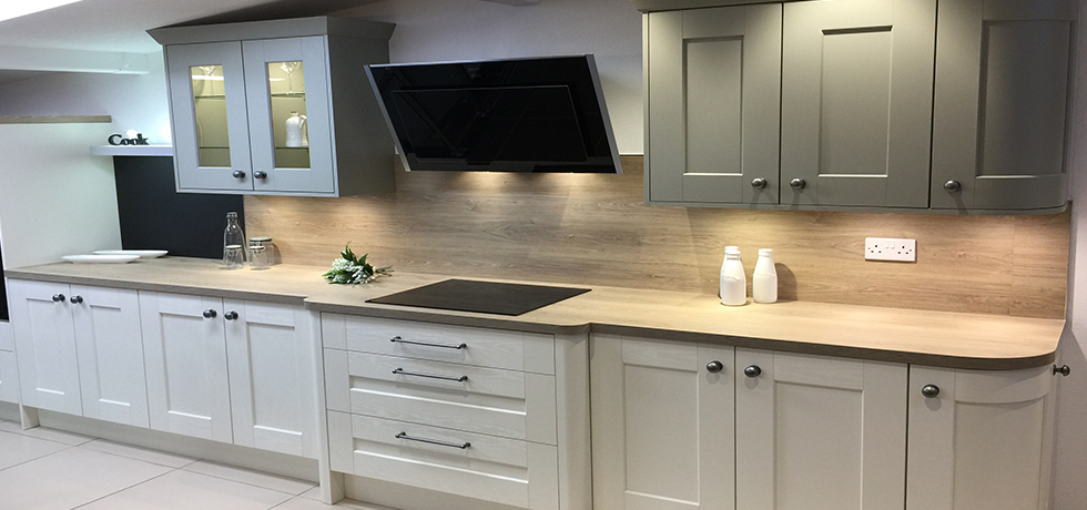 Mike Hughes Kitchen & Bedrooms Ltd displaying Omega Quebec Oak.
