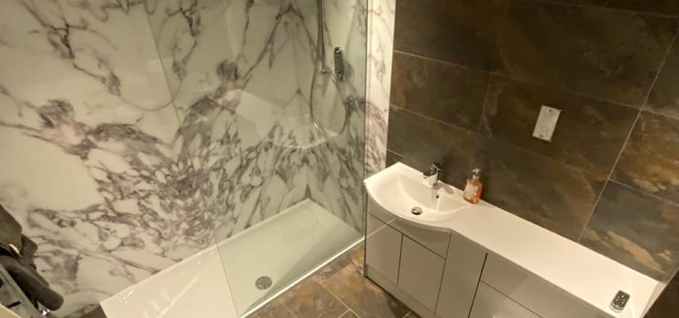 Nuance panels in Carrara Marble fitted by Rothwell Tiles and Bathrooms