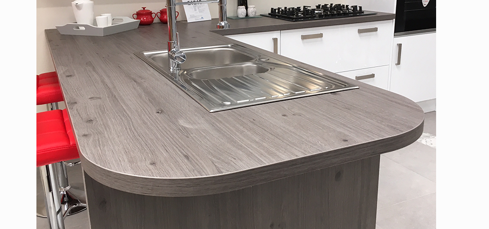 Worcester City Kitchens displaying an Omega Tocbacco Oak curved breakfast bar.